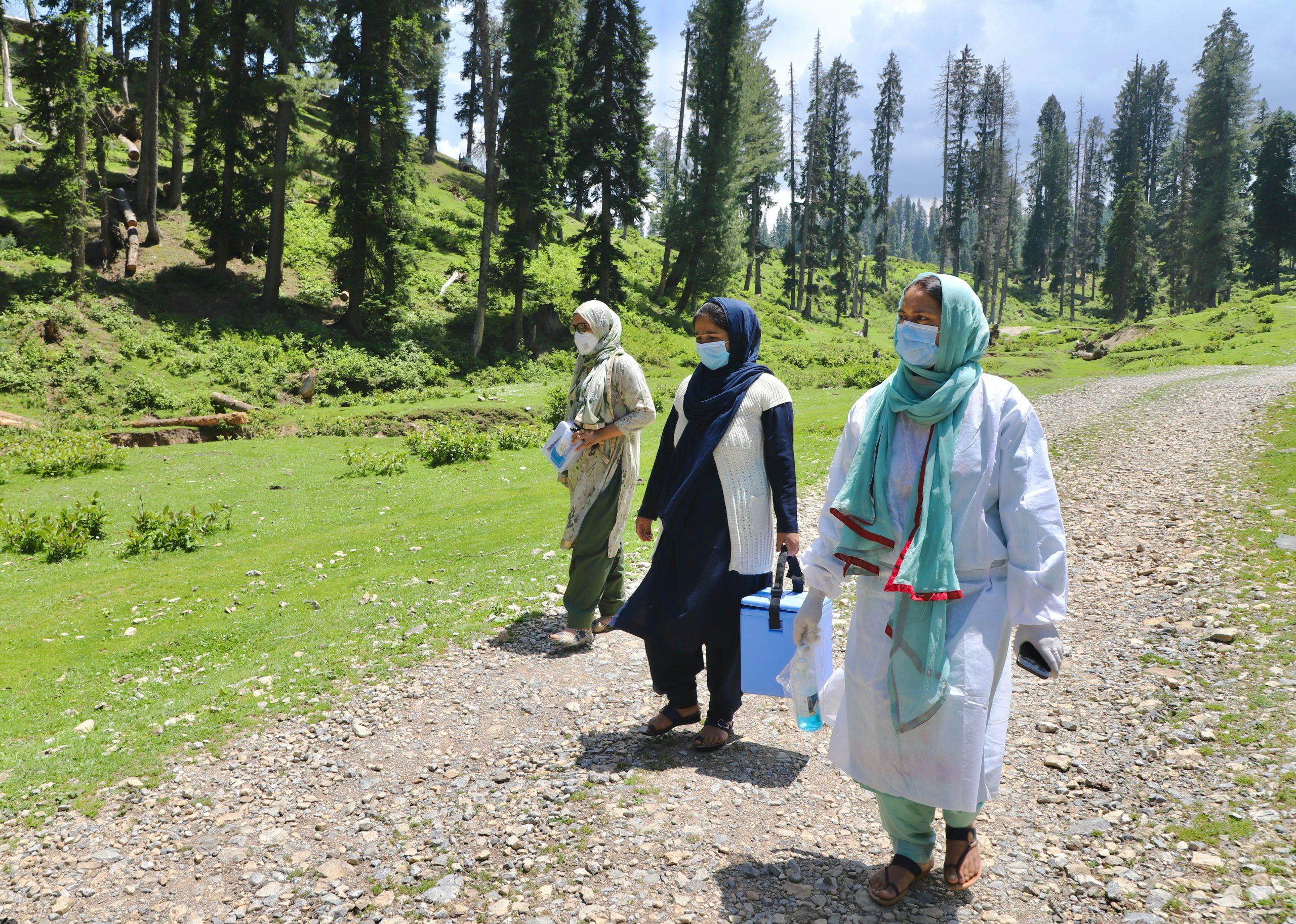 Masooda Akhter and her ASHA colleagues on a vaccine drive in Yusmarg. Photo Credit/ Faisal Bashir